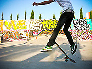 YOUNG SKATER WITH GRAFFITI