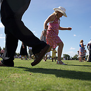 'A Day at the Polo'<br /> Spectators help to tread down the sods of grass at half time during the International Polo Test match between Australia and England at the Windsor Polo Club, Richmond, Sydney, Australia on March 29, 2009. Australia won the match 8-7.  Photo Tim Clayton