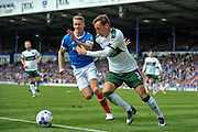 Plymouth Argyle Defender, Gary Sawyer (3) beats Portsmouth Midfielder, Carl Baker (7) to the ball during the EFL Sky Bet League 2 match between Portsmouth and Plymouth Argyle at Fratton Park, Portsmouth, England on 14 April 2017. Photo by Adam Rivers.