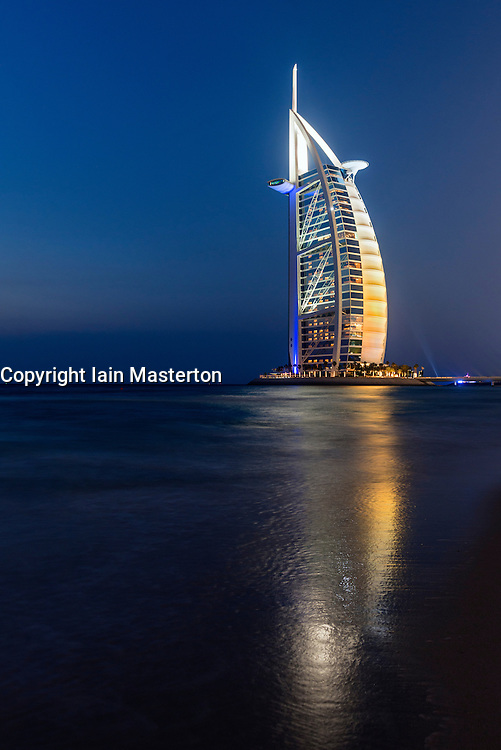 Luxury Burj al Arab Hotel at night in Dubai United Arab Emirates