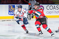 KELOWNA, CANADA - OCTOBER 31: Ryley Lindgren #16 of Lethbridge Hurricanes stick checks Dillon Dube #19 of Kelowna Rockets on October 31, 2015 at Prospera Place in Kelowna, British Columbia, Canada.  (Photo by Marissa Baecker/Shoot the Breeze)  *** Local Caption *** Ryley Lindgren; Dillon Dube;