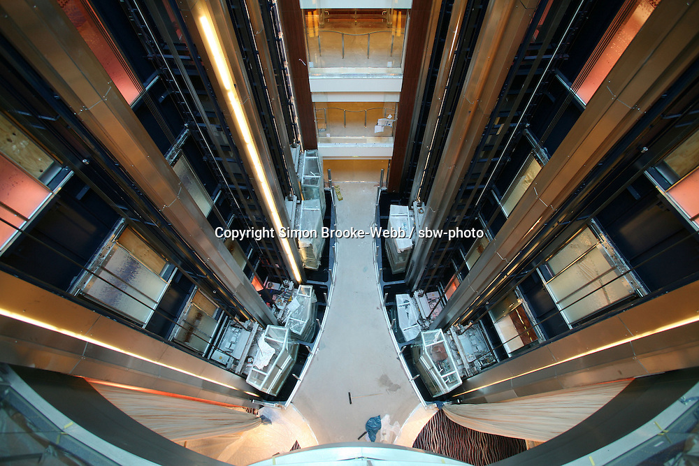 Celebrity Solstice, the most widely heralded ship to enter the cruise industry this year, sets sail from Papenburg Germany, where she was built.  This is the first of 5 Solstice class ships Celebrity Cruises will launch between now and 2012 and the first cruise ship with an authentic grass lawn on its top deck...View down a lift atrium.