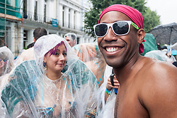 © Licensed to London News Pictures. 31/08/2015. London, UK. Dancers and revellers brave the heavy rain to take part in Notting Hill Carnival, Europe's biggest Caribbean festival. Photo credit : Stephen Chung/LNP