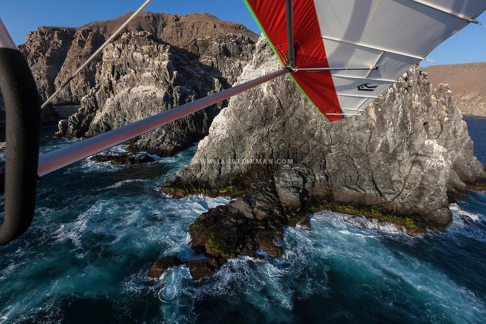 An outing in an ultralight plane provides spectacular closeup views of the stunning beaches near Todos Santos in Baja California Sur, Mexico.