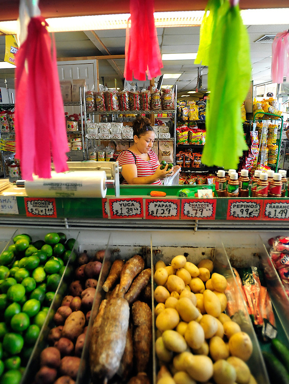 Angelica Martinez shops for fresh produce at Los Compadres on Thursday, Sept. 23, 2010 in Athens, Ga.  Several hispanic markets like Los Compadres have opened in Athens in recent years.
