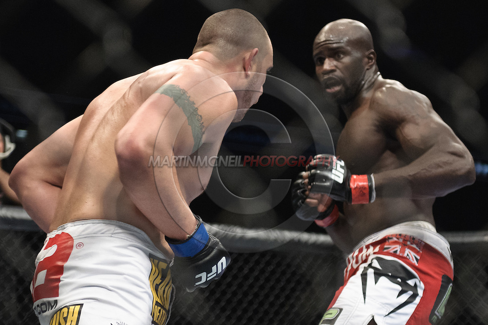 "LONDON, ENGLAND, OCTOBER 2010: Travis Browne (left) closes the distance with Cheick Kongo during ""UFC 120: Bisping vs. Akiyama"" inside the O2 Arena in Greenwich, London"