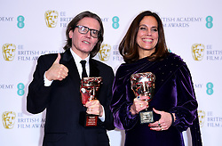Stephen Woolley and Elizabeth Karlsen with their Outstanding British Contribution to Cinema Baftas in the press room at the 72nd British Academy Film Awards held at the Royal Albert Hall, Kensington Gore, Kensington, London.
