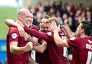 Northampton Town defender Ryan Cresswell celebrates his goal with his team mates  during the Sky Bet League 2 match between Northampton Town and Portsmouth at Sixfields Stadium, Northampton, England on 19 December 2015. Photo by Dennis Goodwin.