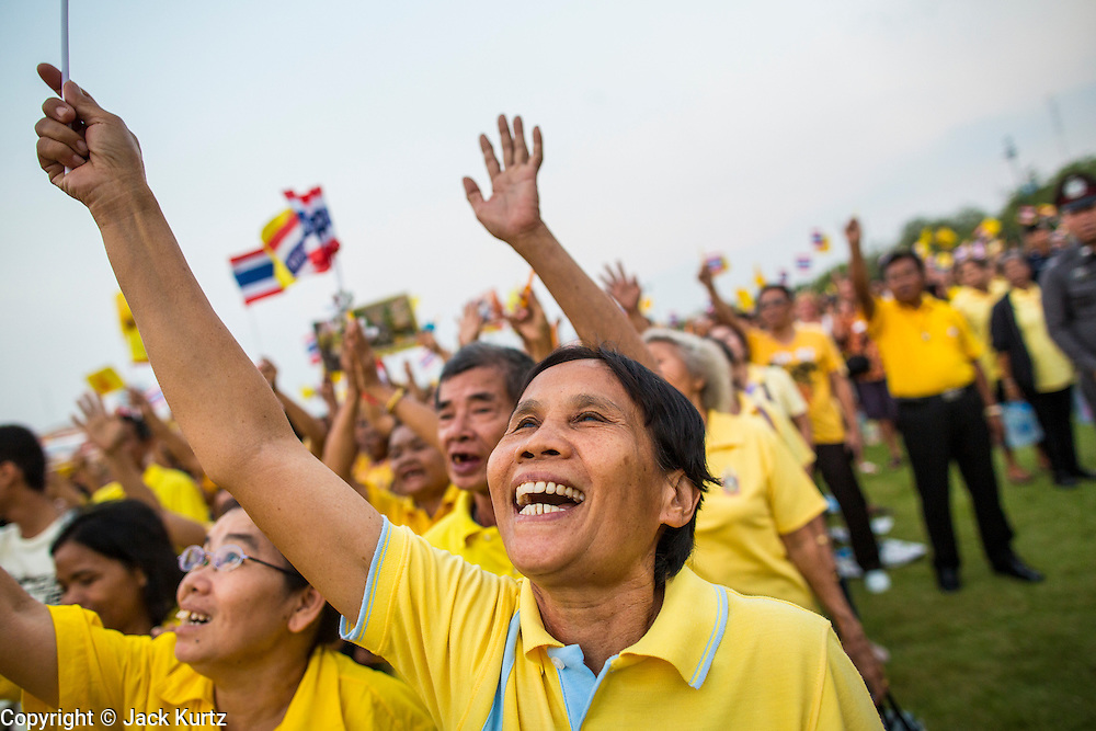 05 DECEMBER 2012 - BANGKOK, THAILAND: Thais cheer their King during the public ceremony to celebrate the birthday of Bhumibol Adulyadej, the King of Thailand, on Sanam Luang, a vast public space in front of the Grand Palace in Bangkok Wednesday night. The King celebrated his 85th birthday Wednesday and hundreds of thousands of Thais attended the day long celebration around the Grand Palace and the Royal Plaza, north of the Palace. The Thai monarch is revered by most Thais as unifying force in Thailand's society, which is not yet recovered from the political violence of 2010.      PHOTO BY JACK KURTZ