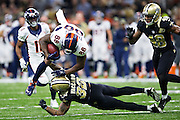NEW ORLEANS, LA - NOVEMBER 13:  Demaryius Thomas #88 of the Denver Broncos is tackled by Kenny Vaccaro #32 of the New Orleans Saints at Mercedes-Benz Superdome on November 13, 2016 in New Orleans, Louisiana.  The Broncos defeated the Saints 25-23.  (Photo by Wesley Hitt/Getty Images) *** Local Caption *** Demaryius Thomas; Kenny Vaccaro