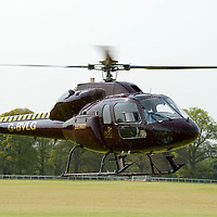 PDG Helicopters, Cumbernauld Eurocopter AS355F1, F2 Twin Squirrel taking off from Perth Races.<br /> Picture by Graeme Hart.<br /> Copyright Perthshire Picture Agency<br /> Tel: 01738 623350  Mobile: 07990 594431