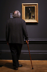 A visitor admires Portrait of Theodore Duret, at a preview of the new Edouard Manet portraiture exhibition at the Royal Academy of Arts in London, Tuesday, 22nd January 2013.Photo by: Stephen Lock / i-Images