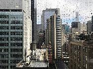 Water drops on window of Manhattan building.