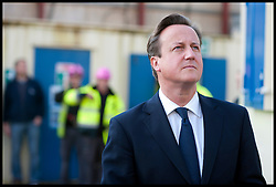 David Cameron talks to workers as he visits a building site during the Conservative Party Conference at ICC, Birmingham, on the second day of the Party Conference, Tuesday October 9, 2012. Birmingham, England. Photo by Andrew Parsons / i-Images..