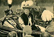 William II (1859-1941) Emperor of Germany from 1888-1919,  in the uniform of the Totenkopf  (Deathshead) Hussars riding in an open carriage with his consort, Empress Augusta Victoria.