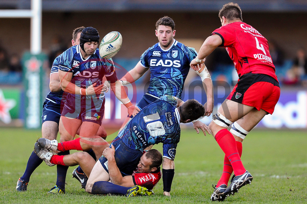 Cardiff Fly-Half (#10) Ceri Sweeney is tackled by Toulon Scrum-Half (#9) Frederic Michalak during the first half of the match - Photo mandatory by-line: Rogan Thomson/JMP - Tel: Mobile: 07966 386802 21/10/2012 - SPORT - RUGBY - Cardiff Arms Park - Cardiff. Cardiff Blues v Toulon (RC Toulonnais) - Heineken Cup Round 2
