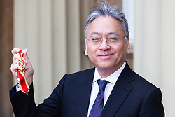 Author Sir Kazuo Ishiguro poses with his Knights Bachelor Medal after being knighted at an investiture by HRH The Prince of Wales at Buckingham Palace in London. London, February 07 2019.