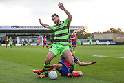 Forest Green Rovers Aarran Racine(21) is tackled from behind by Aldershot Town's Shamir Fenelon(7) during the Vanarama National League match between Forest Green Rovers and Aldershot Town at the New Lawn, Forest Green, United Kingdom on 5 November 2016. Photo by Shane Healey.