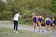 Washington Huskies director of cross country and track and field Maurica Powell encourages members of her team during the women's 3 mile run at the UW/Seattle University Open at Warren G. Magnuson Park., Friday, Aug. 30, 2019, in Seattle. (Paul Merca/Image of Sport)
