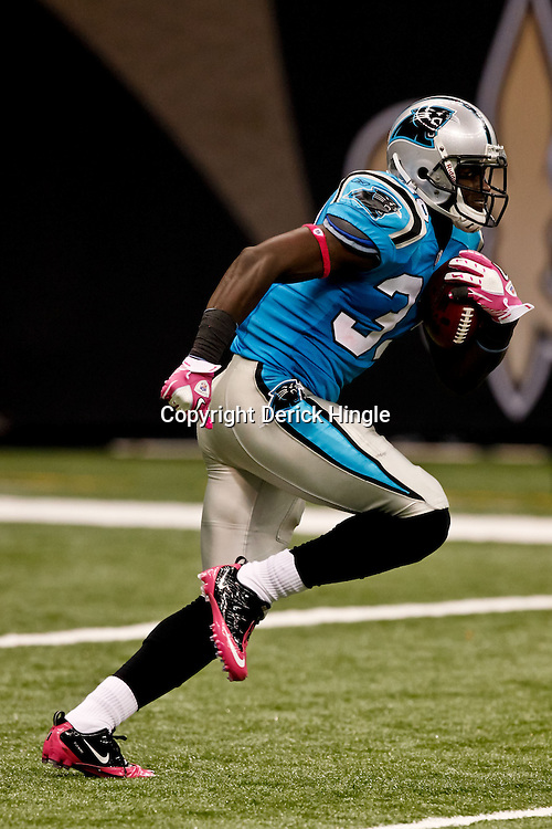 October 3, 2010; New Orleans, LA, USA; Carolina Panthers running back Mike Goodson (33) returns a kickoff against the New Orleans Saints during the second quarter at the Louisiana Superdome. Mandatory Credit: Derick E. Hingle