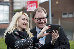 © Licensed to London News Pictures . 19/02/2017. Stoke-on-Trent, UK. GARETH SNELL (r) poses for a photo with a supporter at the Labour Party campaign base on Garth Street . Labour Shadow Chancellor John McDonnell joins Gareth Snell - the party's candidate for the seat of Stoke-on-Trent Central , in the by-election campaign . Photo credit: Joel Goodman/LNP