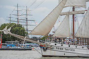 The Loth Lorien passes Greenwich and the Cutty Sark - Royal Greenwich Tall Ships Festival with a fleet of square rigged ships moored on the Thames at Greenwich and Woolwich. The fleet includes two of the biggest Class A Tall Ships - the Dar Mlodziezy and Santa Maria Manuela - which are moored on Tall Ships Island in the river off Greenwich. Tall Ships Festival Day on Saturday 29 August featured free family entertainment and the chance to enjoy a taste of life on the high seas.