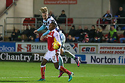 Queens Park Rangers  forward Sebastian Polter (17) wins the heart against Rotherham United defender Darnell Fisher (17)  during the EFL Sky Bet Championship match between Rotherham United and Queens Park Rangers at the New York Stadium, Rotherham, England on 10 December 2016. Photo by Simon Davies.