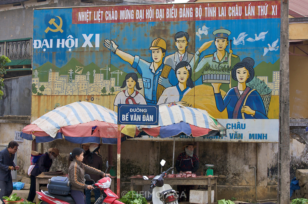 Propaganda at the New Lai Chau, built to accomodate the people of Lai Chau who will be moved when Lai Chau is submerged by a new dam along Song Da (Black River).