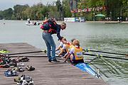 Plovdiv, Bulgaria, 12.05.19,  FISA, Rowing World Cup 1, W4-, NED, NED1, (b) HOGERWERF Ellen (2) FLORIJN Karolien (3) CLEVERING Ymkje (s) MEESTER Veronique, Coach congratulates, crew members, after they won Gold, Finals Day, © Karon PHILLIPS/Intersport Images,