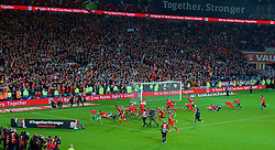 CARDIFF, WALES - Tuesday, October 13, 2015: Wales players run to celebrate with the supporters after qualifying for the finals following a 2-0 victory over Andorra during the UEFA Euro 2016 qualifying Group B match at the Cardiff City Stadium. (Pic by Paul Currie/Propaganda)