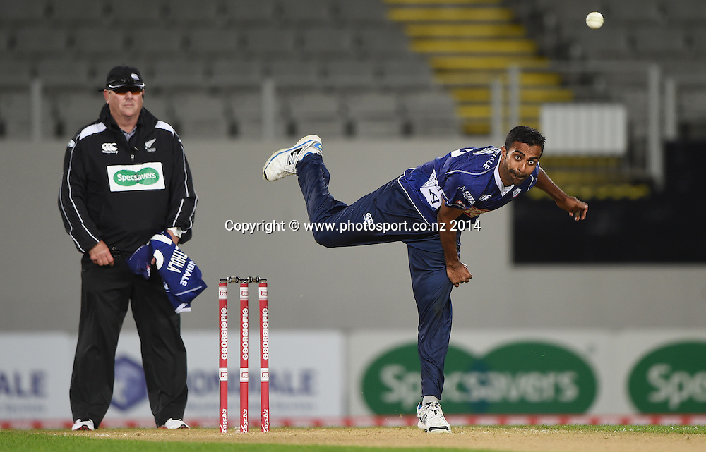 Tarun Nethula bowling for Auckland during the Georgie Pie Super Smash Twenty20 cricket match between the Auckland Aces and Wellington Firebirds at Eden Park, Auckland on Friday 14 November 2014. Photo: Andrew Cornaga / www.Photosport.co.nz