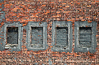 New York, New York City. 4 bricked-up windows in a building.