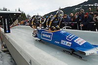 The German team of Andre Lange, Rene Hoppe, Matej Juhart, and Alexander Metzger compete in the Mens' four-person bobsleigh World Cup competition held at the Whistler Sliding Centre on Feb 7, 2009