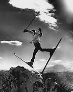 Freezing weather, sunshine and powder snow on Denny Mountain at the Alpental resort near Snoqualmie Pass. Mount Rainier is at right behind the snow crystals left in the skier's wake. (Josef Scaylea / The Seattle Times, 1973)