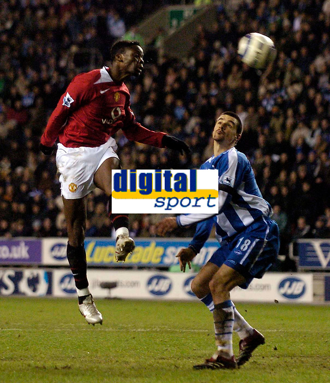 Photo: Jed Wee.<br /> Wigan Athletic v Manchester United. The Barclays Premiership. 06/03/2006.<br /> <br /> Manchester United's Louis Saha (L) has his team's best chance of the first half as he heads goalwards while unmarked, as Wigan's Paul Scharner looks on.