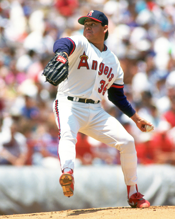 ANAHEIM - 1988:  Fernando Valenzuela of the Los Angeles Angels pitches during an MLB game at The Big A in Anaheim, California during the 1988 season. (Photo by Ron Vesely).  Subject:   Fernando Valenzuela