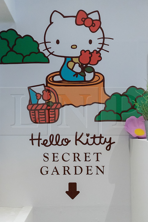 © Licensed to London News Pictures. 01/06/2016. London, UK. Directions to the basement secret garden.  A pop up cafe has opened for the summer at Cutter & Squidge in Soho serving Hello Kitty's Secret Garden Afternoon Tea.  Natural, handmade products inspired by the Hello Kitty character popular worldwide, are on offer in Sanrio's first official Helly Kitty pop up cafe in Europe. Photo credit : Stephen Chung/LNP