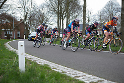 A small group of chasers follow the three-strong break in the second lap of Stage 3 of the Healthy Ageing Tour - a 154.4 km road race, between  Musselkanaal and Stadskanaal on April 7, 2017, in Groeningen, Netherlands.