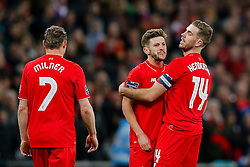 Adam Lallana is held back by Jordan Henderson of Liverpool after a confrontation with Fernandinho and Yaya Toure of Manchester City - Mandatory byline: Rogan Thomson/JMP - 28/02/2016 - FOOTBALL - Wembley Stadium - London, England - Liverpool v Manchester City - Capital One Cup Final.