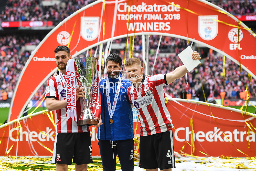 Lincoln City Manager Danny Cowley, Luke Waterfall of Lincoln City (5) and Elliot Whitehouse of Lincoln City (4) celebrate winning the Checkatrade Trophy during the EFL Trophy Final match between Lincoln City and Shrewsbury Town at Wembley Stadium, London, England on 8 April 2018. Picture by Stephen Wright.
