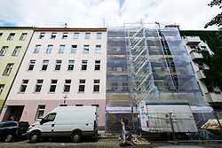 Apartment building being renovated in upcoming Neukolln district in Berlin Germany