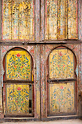 MARRAKESH, MOROCCO - 19TH APRIL 2016 - A colourful and intricately painted, old wooden doorway in the Marrakesh old medina, Morocco.