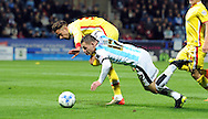 Harry Bunn of Huddersfield Town tangles with Diego Poyt of Milton Keynes Dons during the Sky Bet Championship match at the John Smiths Stadium, Huddersfield<br /> Picture by Graham Crowther/Focus Images Ltd +44 7763 140036<br /> 20/10/2015