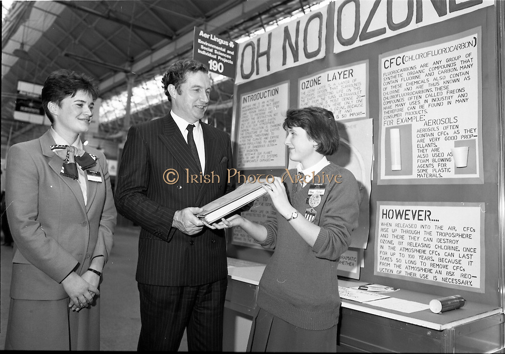 05/01/1989.01/05/1989.5th January 1989.The Aer Lingus Young Scientist of the Year Award at the RDS, Dublin..Picture shows Michael Smith, T.D., Minister for Energy with Aileen Maher, St Mary's Secondary School, Nenagh, Co. Tipperary explaining her project 'Oh No Ozone.' Louise Curran of Aer Lingus is also in picture.
