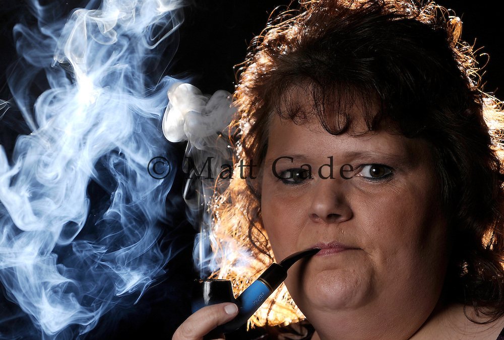 Sandy Sian of Lowell is the first-ever woman champion of the International Pipe Smokers Clubs smoking competition, winning the competition in 1 hour 20 minutes and 48 seconds back on October 29..Date Shot 11-10-2011.(Matt Gade | The Grand Rapids Press)