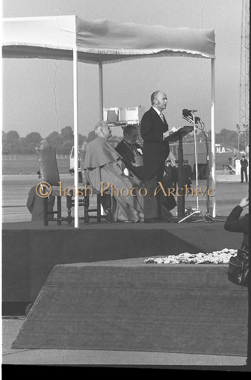 Pope John-Paul II visits Ireland..1979..29.09.1979..09.29.1979..29th September 1979..Today marked the historic arrival of Pope John-Paul II to Ireland. He is here on a three day visit to the country with a packed itinerary. He will celebrate mass today at a specially built altar in the Phoenix Park in Dublin. From Dublin he will travel to Drogheda by cavalcade. On the 30th he will host a youth rally in Galway and on the 1st Oct he will host a mass in Limerick prior to his departure from Shannon Airport to the U.S..On behalf of the Irish people President Hillery is pictured welcoming Pope John-Paul II to Ireland on his historic visit.