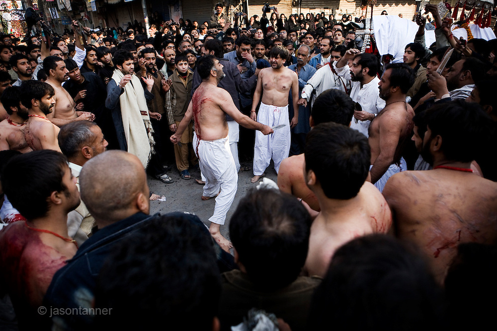A Shiite religious procession on the 10th day of the holy Islamic month of Muharram in Islamabad..Shiites commemorated Ashura across Pakistan, beating their chests and flailing themselves with chains to commemorate the killing of Imam Hussein by armies of the Sunni caliph Yazid at the Battle of Kerbala on 10th October, 680AD.