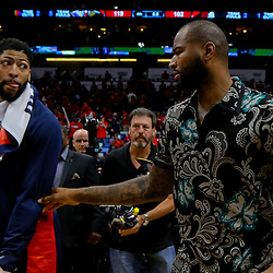 Apr 19, 2018; New Orleans, LA, USA; New Orleans Pelicans center DeMarcus Cousins  with forward Anthony Davis  following a win against the Portland Trail Blazers in game three of the first round of the 2018 NBA Playoffs at the Smoothie King Center. The Pelicans defeated the Trail Blazers 119-102.  Mandatory Credit: Derick E. Hingle-USA TODAY Sports