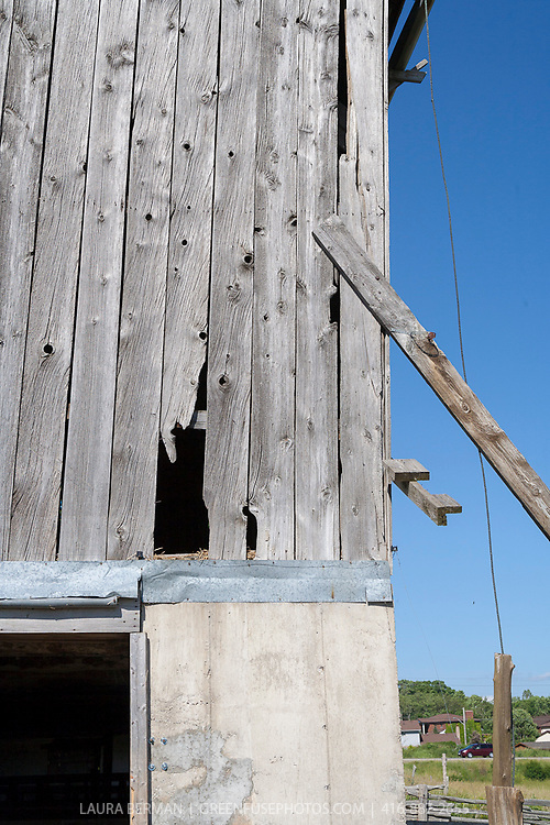 Exterior of an old barn in need of repair.
