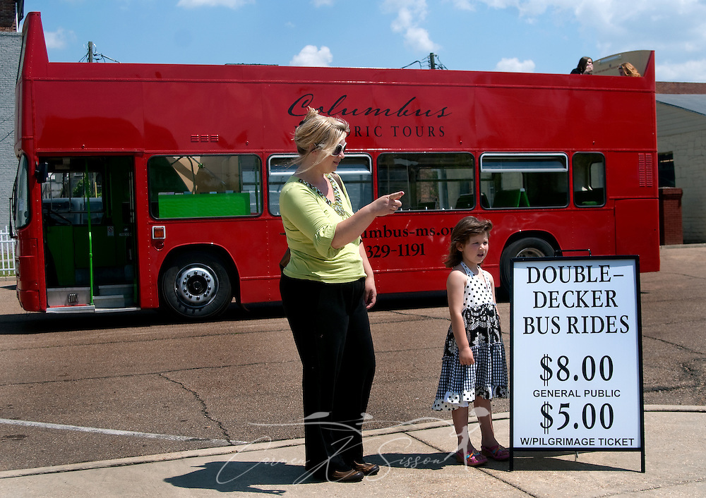 Jennifer Miller (left) points out the sights to her daughter, five-year-old Katie Rose Miller, as they wait for a double-decker bus ride at the Tennessee Williams Welcome Center in Columbus, Miss. April 17, 2010. Rides are $8 and include stops at many of the historic, antebellum homes throughout the city. (Photo by Carmen K. Sisson/Cloudybright)